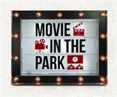 "Marquee sign with lights that says ""Movie in the Park"""