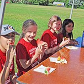Kids eating a snack at Safety Camp