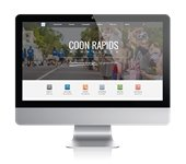 Computer monitor displaying the Coon Rapids website
