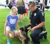 Girl petting a police K-9