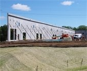 Construction of new office-warehouse building along Highway 10