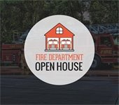 Red fire house with two engines inside