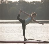 Woman in a yoga pose on a paddleboard