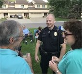 Police officer speaking with members of the community