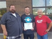 Alloy Brewing owners pose with award