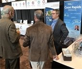People talking at a trade show
