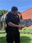 pic of officer platz reading