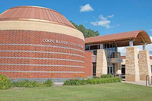 Exterior photo of Coon Rapids City Hall entrance and council chamber