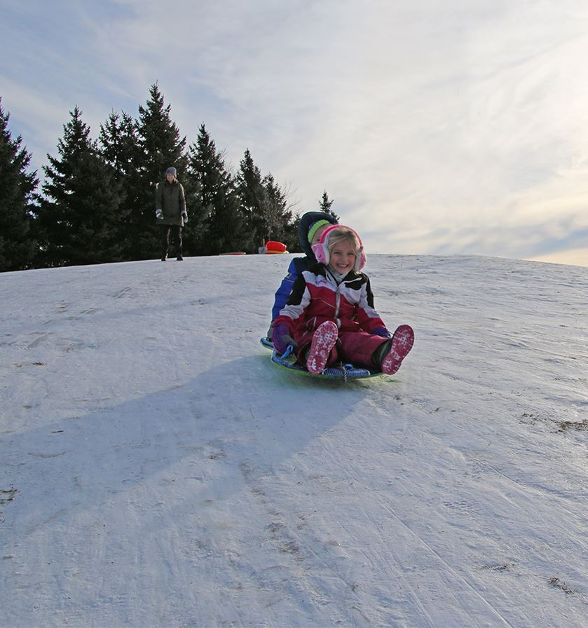 Children sledding at Wintercrest Sledding Hill