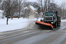 snowplowing truck on road