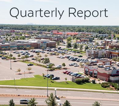 "Aerial view of commercial development, titled ""Quarterly Report"""
