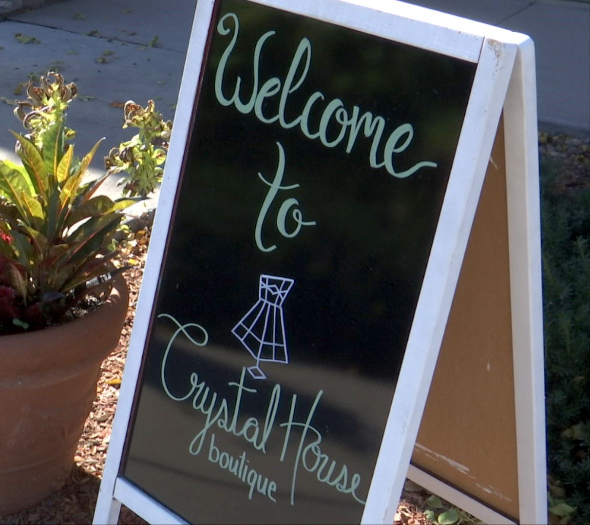 sandwich board sign for Crystal House boutique
