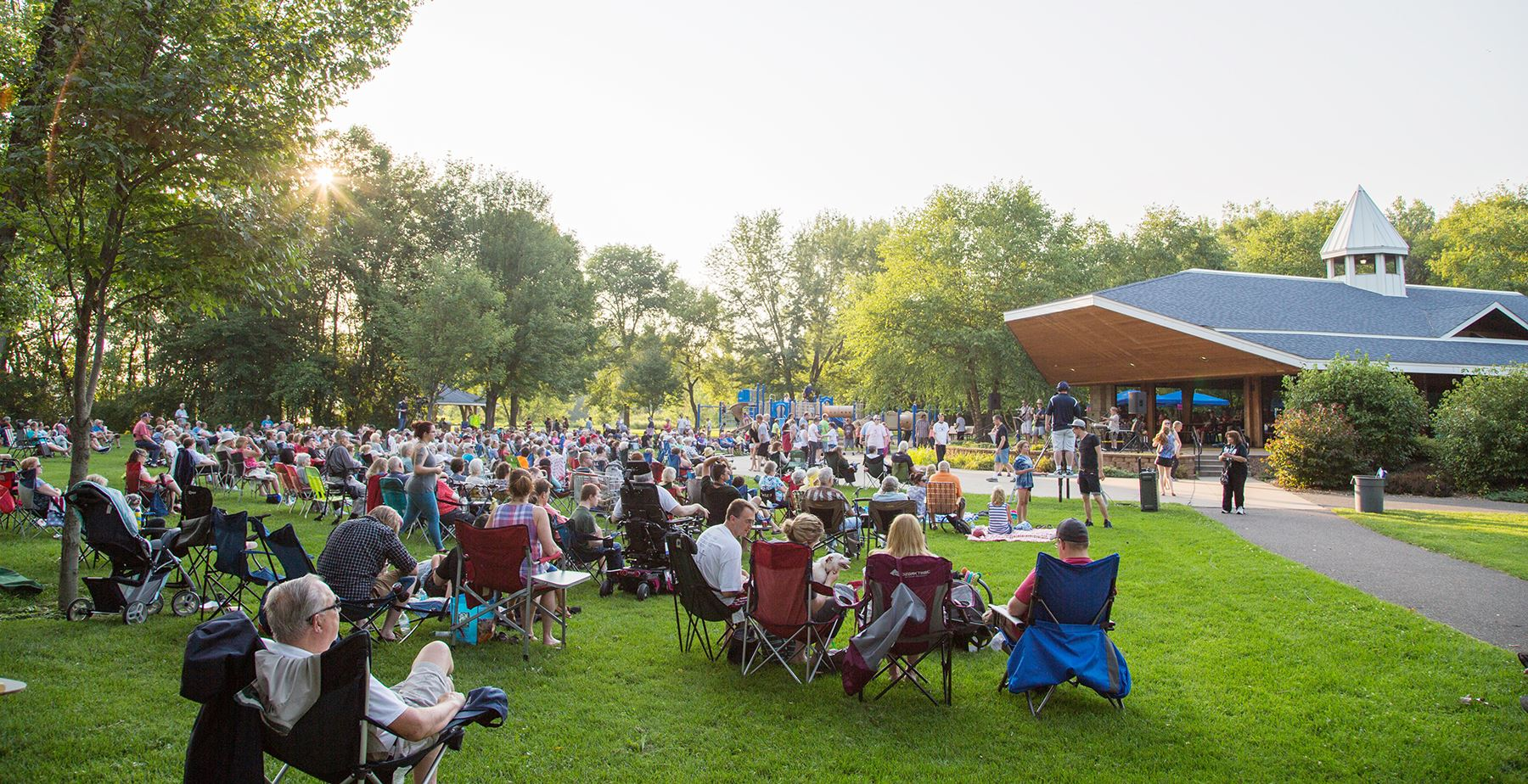 The community gathers for a summer concert at the Coon Rapids Dam